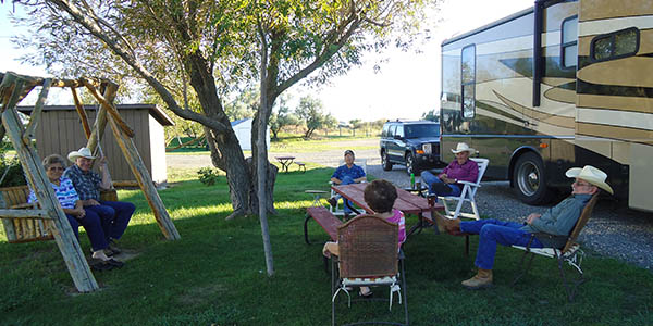 Photo of people sitting in front of an rv at Grand View Campground in Hardin MT