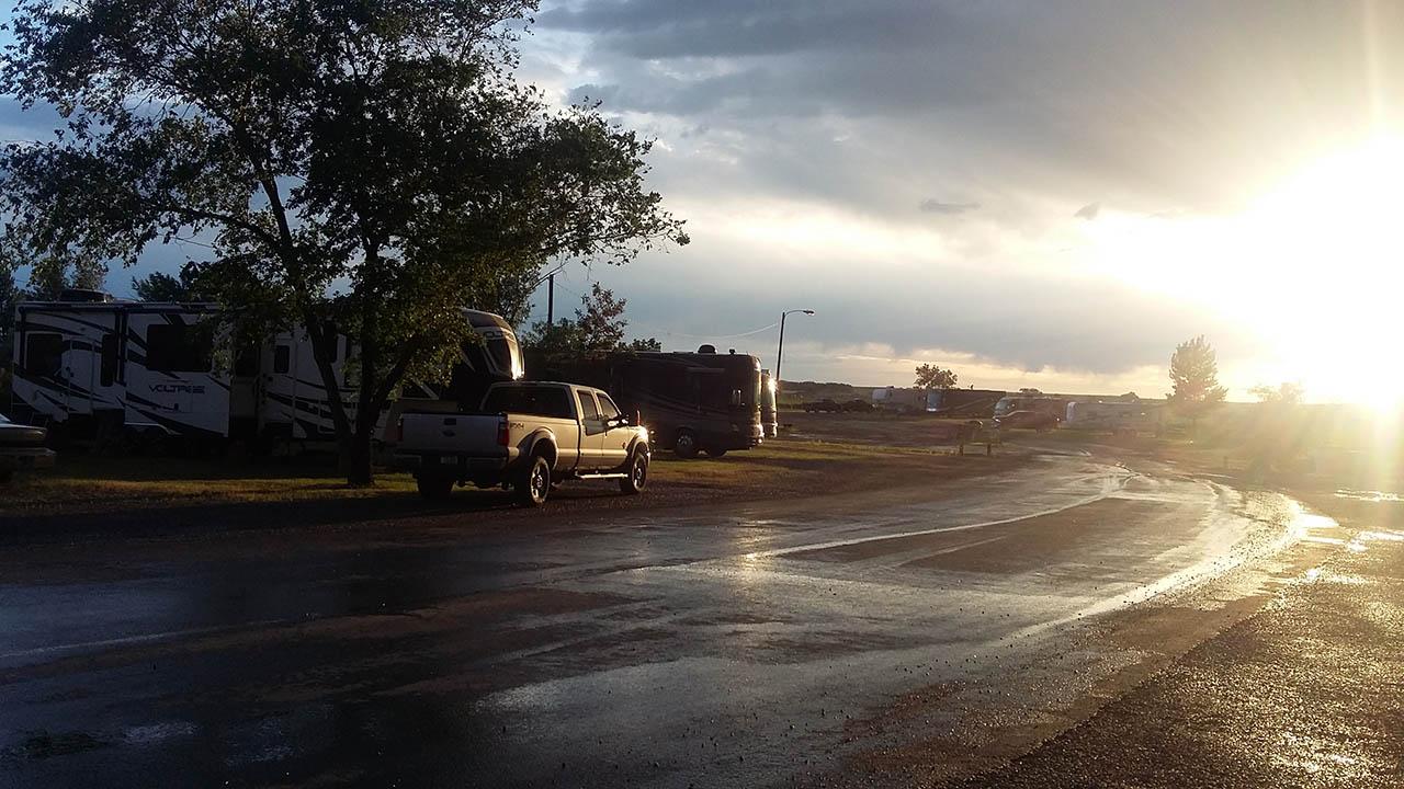 rv site with rainy road